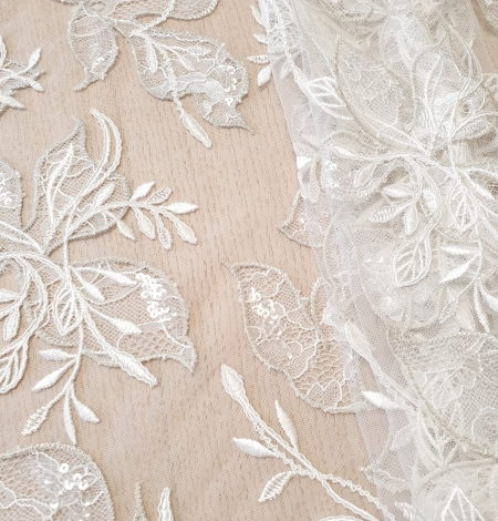 Ivory with silver thread embroidery on tulle lace fabric. Photo 1