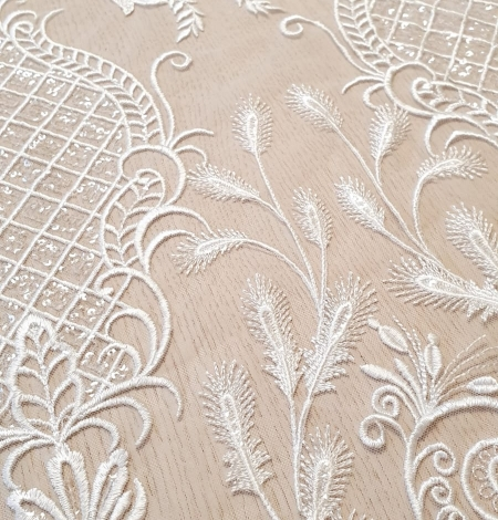 Ivory embroidery on tulle fabric. Photo 2