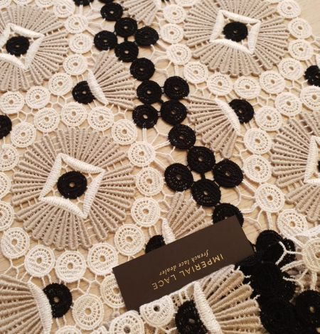 Beige with black and white macrame lace fabric. Photo 2