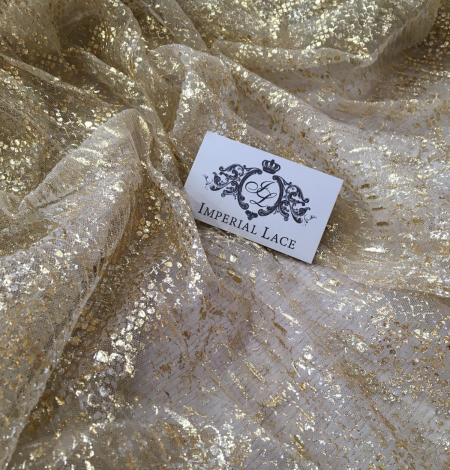 Nude pleated tulle fabric with gold spotting. Photo 1