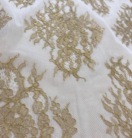 Gold lace fabric. Photo 7