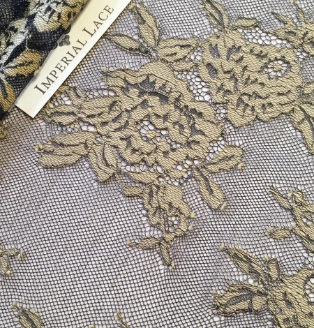 Black with beige flowers lace fabric. Photo 7