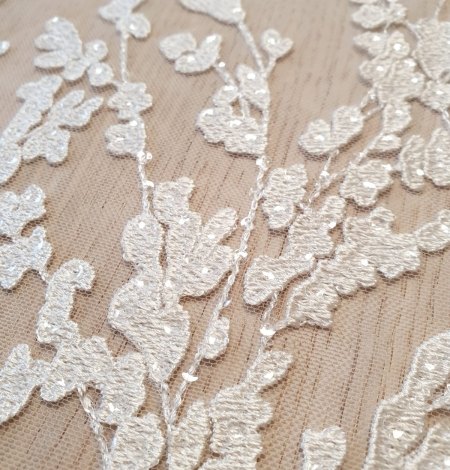 Ivory embroidery on tulle lace fabric. Photo 3