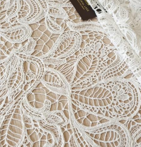 Ivory floral pattern macrame lace fabric . Photo 1