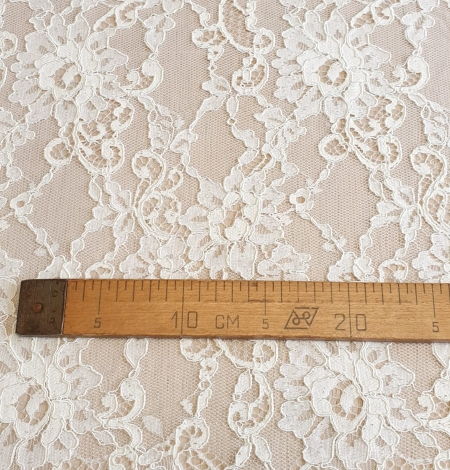 Champagne guipure lace fabric. Photo 7