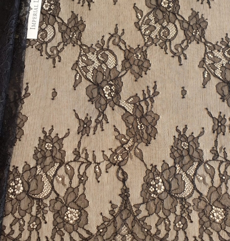 Black floral Chantilly lace fabric. Photo 1