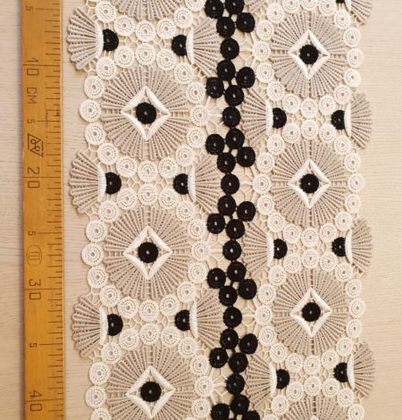 Beige with black and white macrame lace fabric. Photo 7