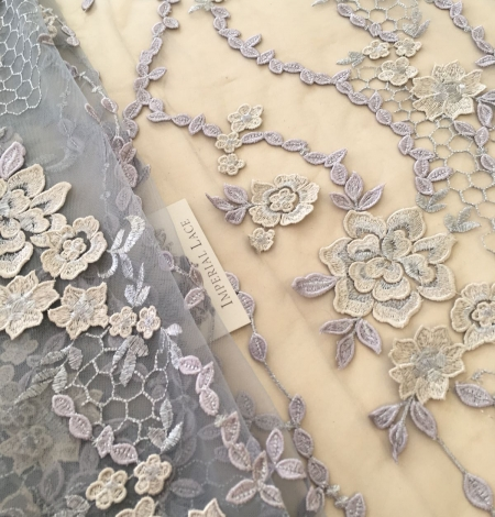 Greyish blue embroidery on tulle fabric. Photo 4
