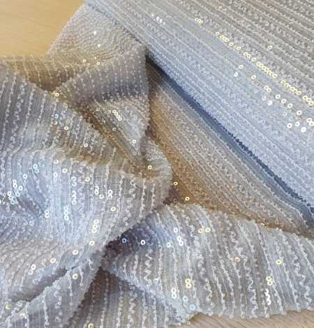 Light blue tulle with sequins and beads fabric. Photo 4