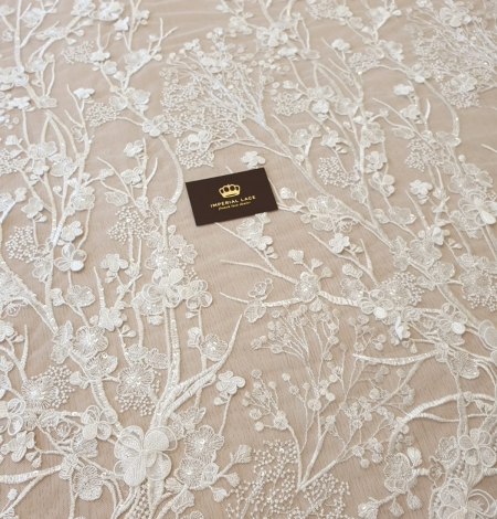 Ivory floral embroidery on tulle fabric. Photo 2