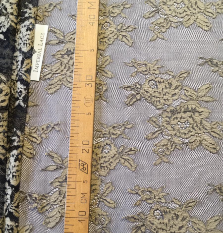 Black with beige flowers lace fabric. Photo 9