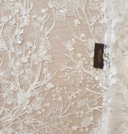 Ivory floral embroidery on tulle fabric. Photo 6