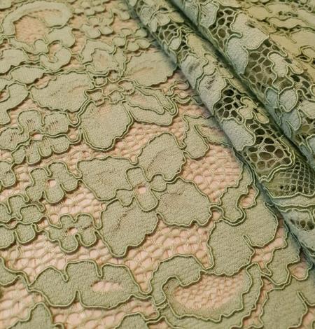 Light apple green guipure lace fabric. Photo 3