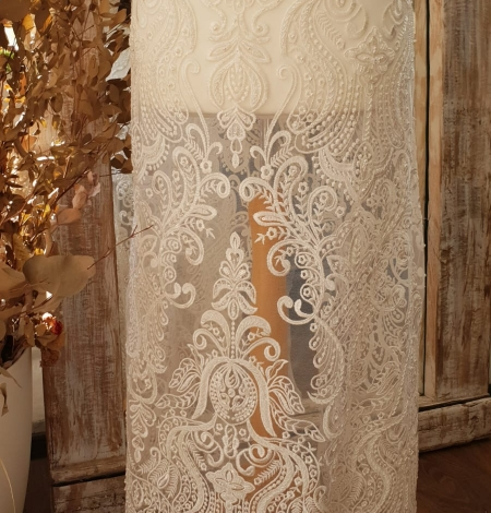 Ivory embroidery on tulle lace fabric. Photo 9