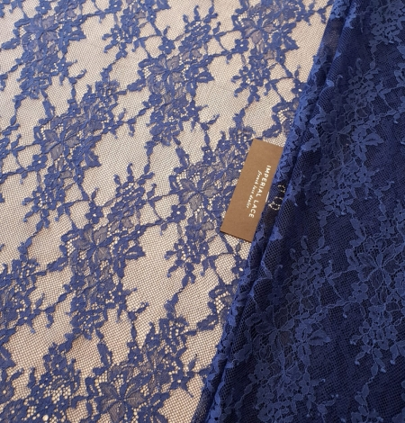 Blue 100% polyester floral chantilly lace fabric. Photo 1