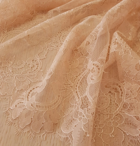 Nude 100% polyester floral chantilly lace fabric. Photo 7