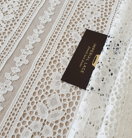 Ivory chantilly floral and stripes lace fabric. Photo 1