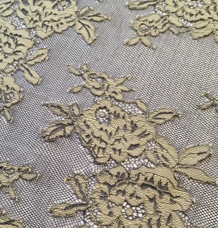 Black with beige flowers lace fabric. Photo 3