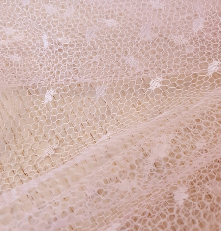 Light pink dotted tulle fabric. Photo 6