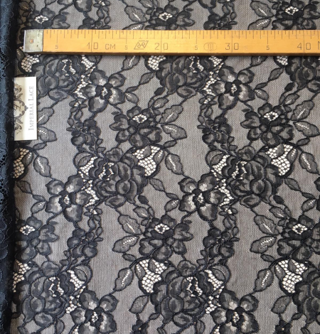 Black floral pattern lace fabric . Photo 7