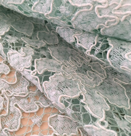 Mint green lace fabric. Photo 2
