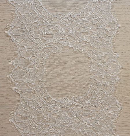 Ivory chantilly lace trimming from France. Photo 2