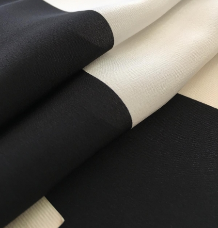 Silk Crepe fabric with white and black print. Photo 6