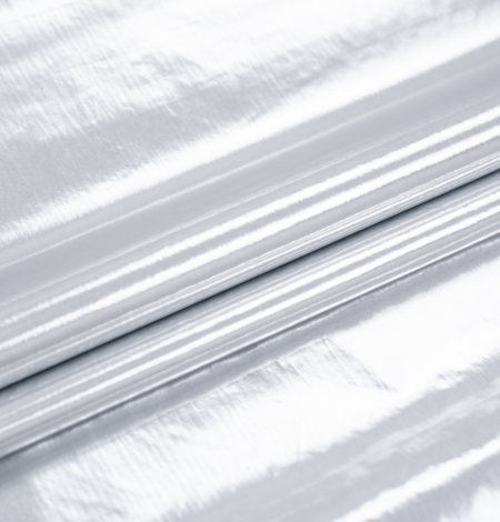 Silver color shiny rain coat fabric. Photo 8