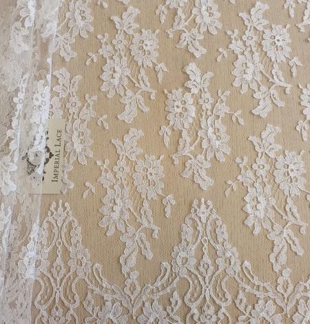 White chantilly lace fabric . Photo 1