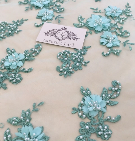 Green 3D lace fabric. Photo 3