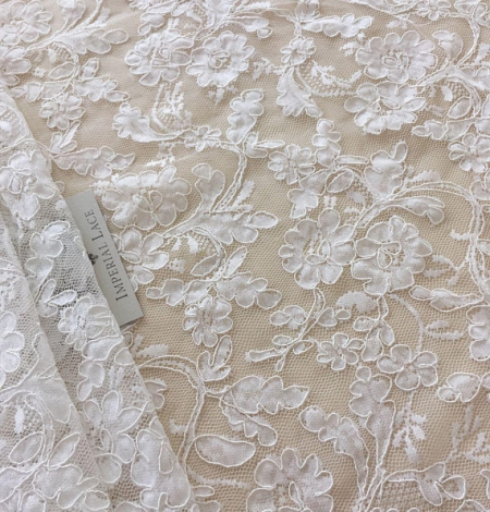 White lace fabric. Photo 1
