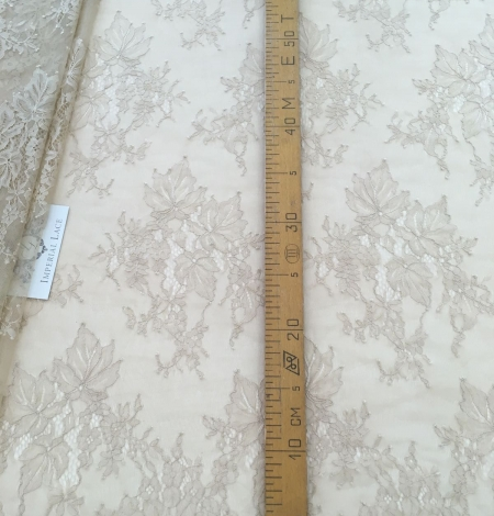 Beige lace fabric. Photo 8