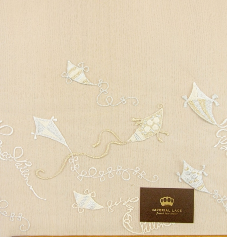 Golden figurative pattern on white tulle fabric. Photo 8
