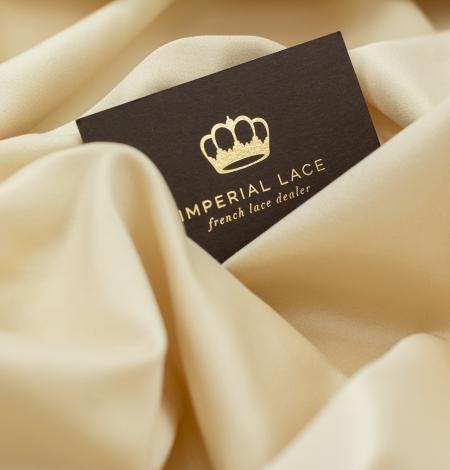Cream color silk duchess fabric . Photo 7