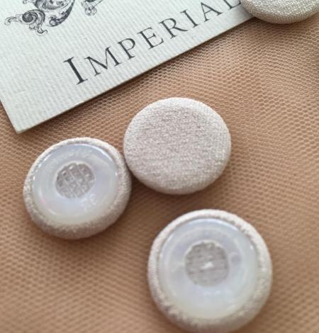 Beige button. Photo 3