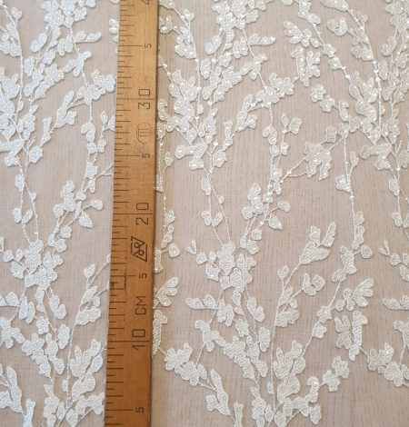 Ivory embroidery on tulle lace fabric. Photo 6