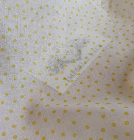White with yellow dots cotton fabric. Photo 3