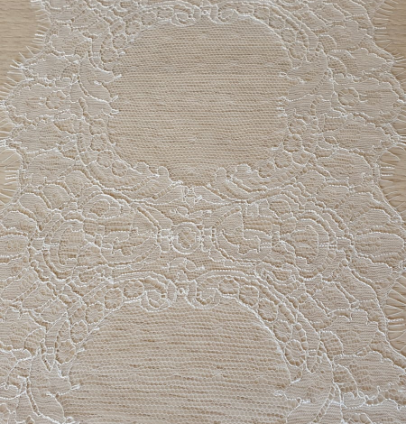 Ivory chantilly lace trimming from France. Photo 7