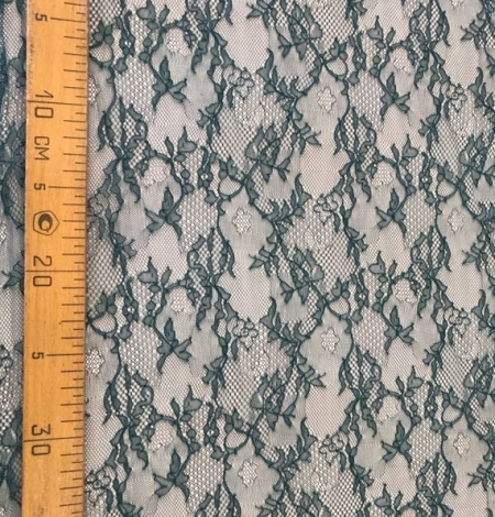 Deep teal green lace fabric. Photo 6