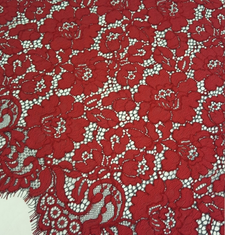 Red with black guipure lace fabric . Photo 2