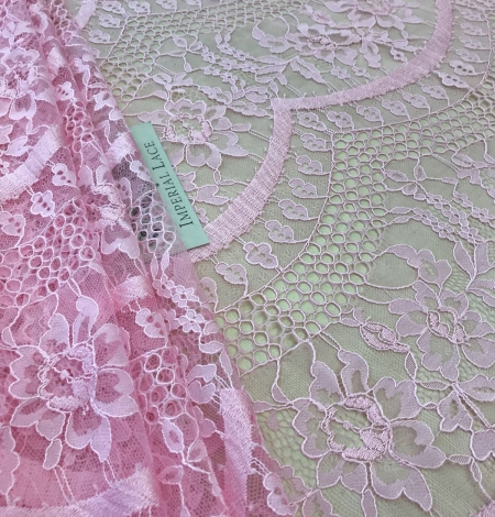 Pink lace fabric. Photo 1