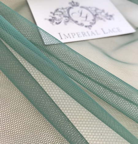 Green tulle fabric. Photo 8