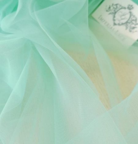 Mint green tulle fabric. Photo 4