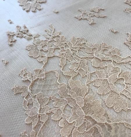 Rusty yellow lace fabric. Photo 5