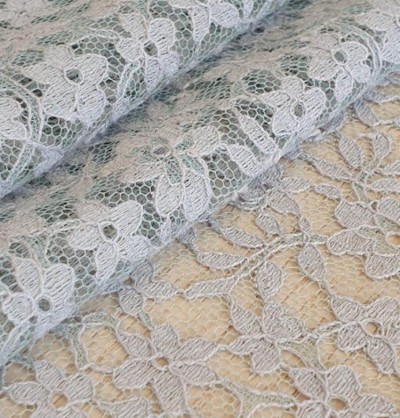 Grey with bluish green base lace fabric. Photo 6