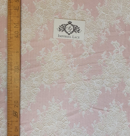 Pink with white flower pattern fabric. Photo 7