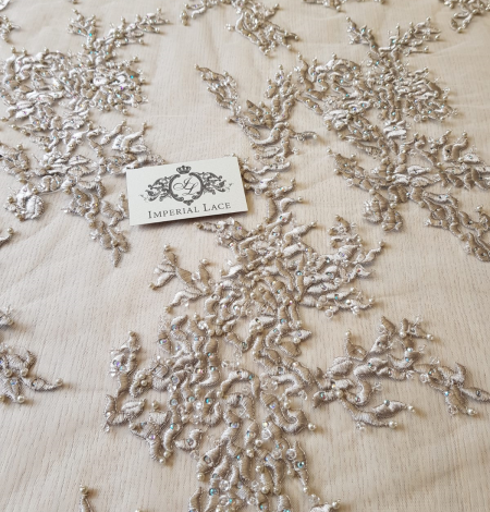 Beige embroidery on tulle fabric . Photo 8