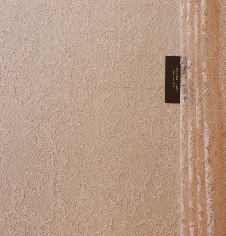 Nude 100% polyester floral chantilly lace fabric. Photo 9