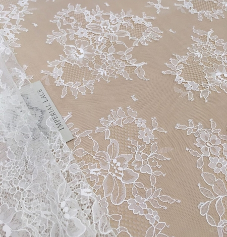 Off white chantilly floral lace fabric. Photo 1
