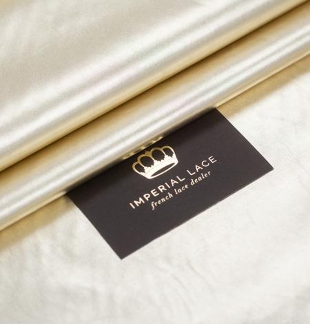 Gold color shiny rain coat fabric. Photo 1